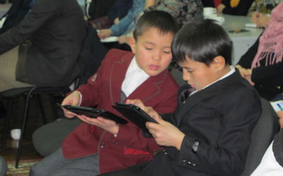 kyrgyz children with tabs
