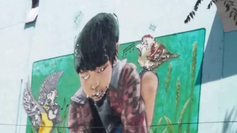 «Как из фильма ужасов». Горожанка жалуется на граффити на стене музыкального училища имени Куренкеева. Фото